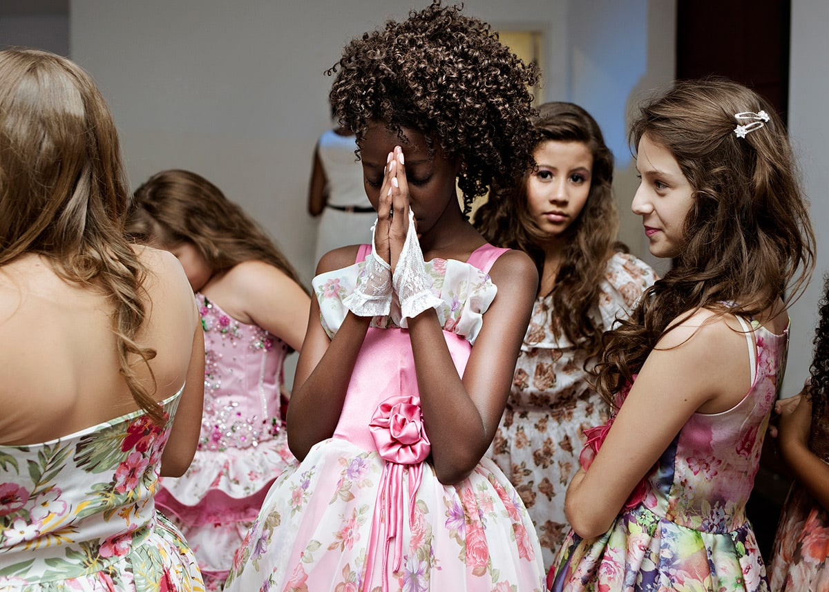 Maysa prays before her turn on stage during the final contest for Young Miss Sao Paulo 2015. Sao Paulo, Brazil. January 21, 2015.