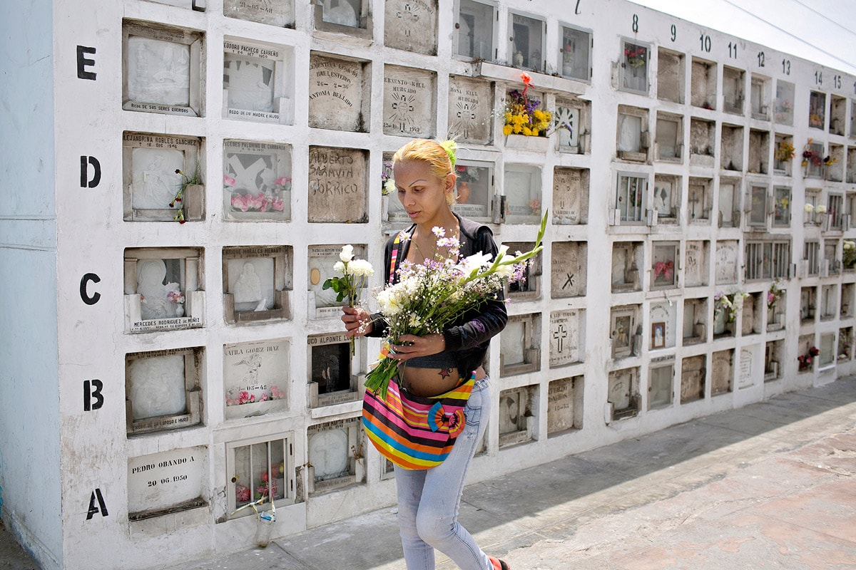 Nearly every week, Yasuri visits the Baquijano Cemetery to leave flowers and pray at a Peruvian saint's tomb.