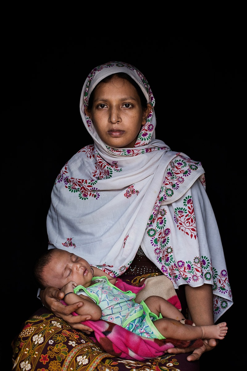 Shamina Yasmin, 25, and her daughter Sharmin Yasmin, one month. Rohingya Taung Bazar survivor.