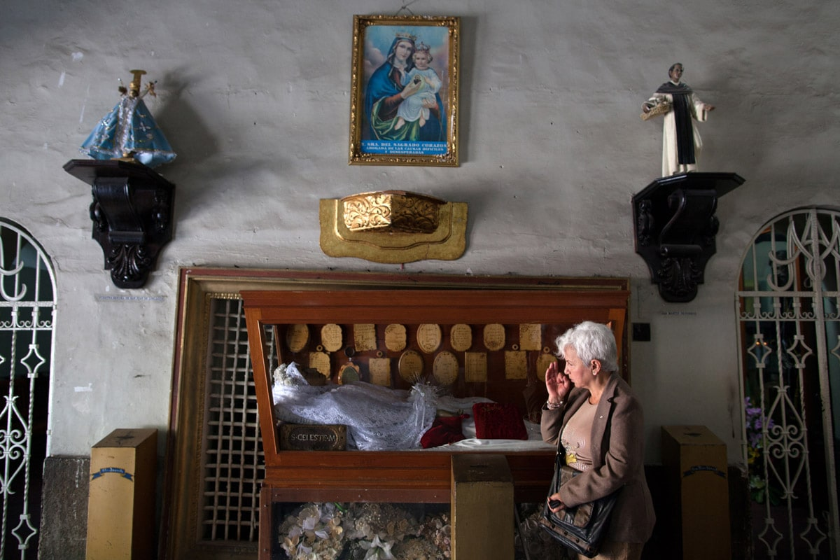 Sonia, a resident of Casa Xochiquetzal, prays at a church in Mexico City.